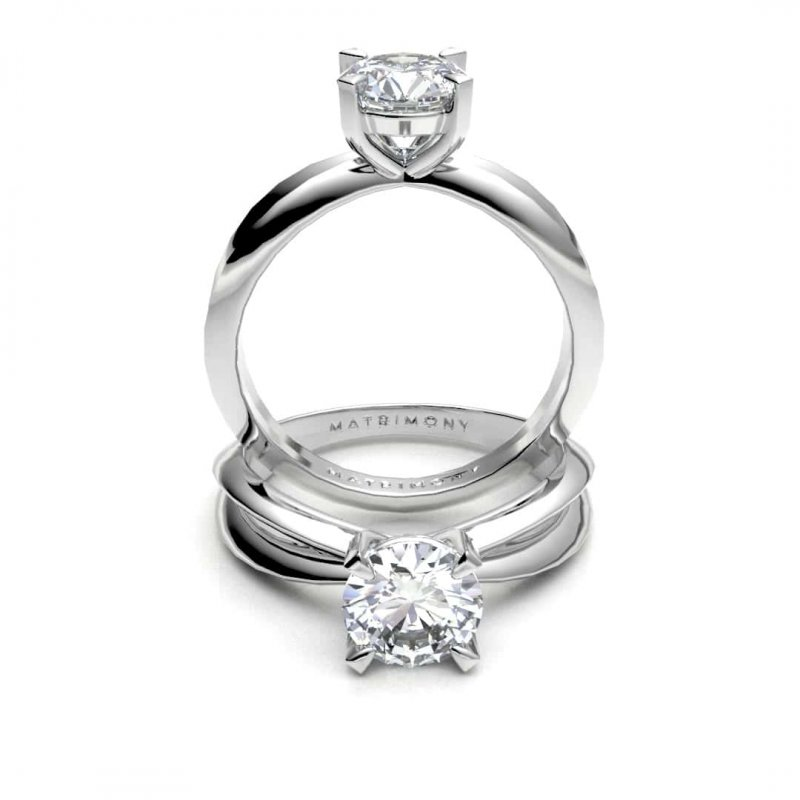 Hermoso anillo de compromiso solitario con piedras laterales y diamante redondo. Este modelo se encuentra disponible con piedras de zirconia ó diamante y en oro de 9k, 14k, 18k ó platino.