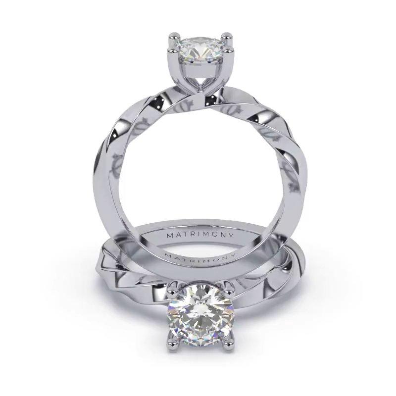 Hermoso anillo de compromiso con diamante redondo. Este modelo se encuentra disponible con piedras de zirconia o diamante, además de poderse crear con oro de 9k, 14k, 18k y platino.