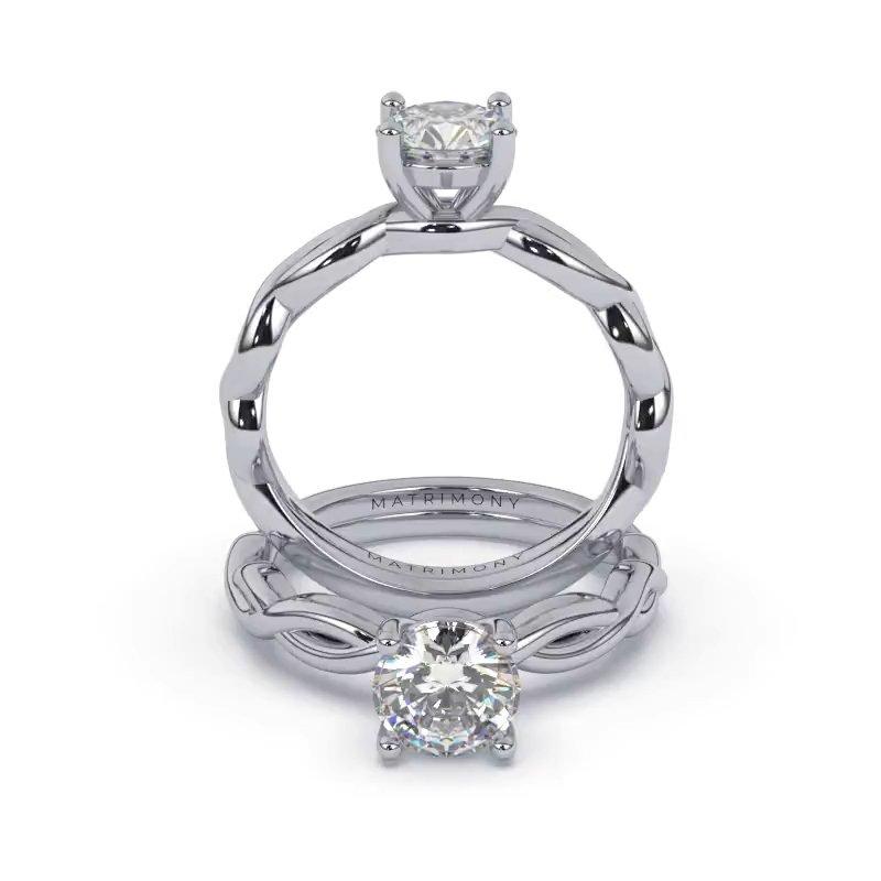 Hermoso anillo de compromiso solitario y diamante redondo. Este modelo se encuentra disponible con piedras de zirconia o diamante, además de poderse crear con oro de 9k, 14k, 18k y platino.