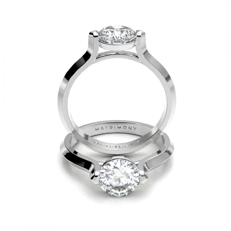 Hermoso anillo de compromiso solitario con un diamante redondo. Este modelo se encuentra disponible con piedras de zirconia ó diamante y en oro de 9k, 14k, 18k ó platino.